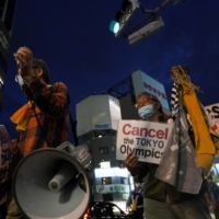 Anti-Olympics demonstrators gather during a protest march in Tokyo on May 17. | REUTERS