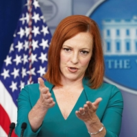White House press secretary Jen Psaki speaks to reporters in Washington on Tuesday. Psaki said U.S. supports the holding of the Tokyo Olympics, with strict protocols, and that athletes heading to the country are among 'one of the very limited categories of U.S. travelers that are actually planning on going to Japan for the Olympics.' | REUTERS