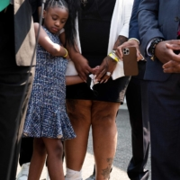 George Floyd's daughter Gianna Floyd looks on as members of Floyd's family speak outside the White House after meeting with U.S. President Joe Biden in Washington on Tuesday.   AFP-JIJI