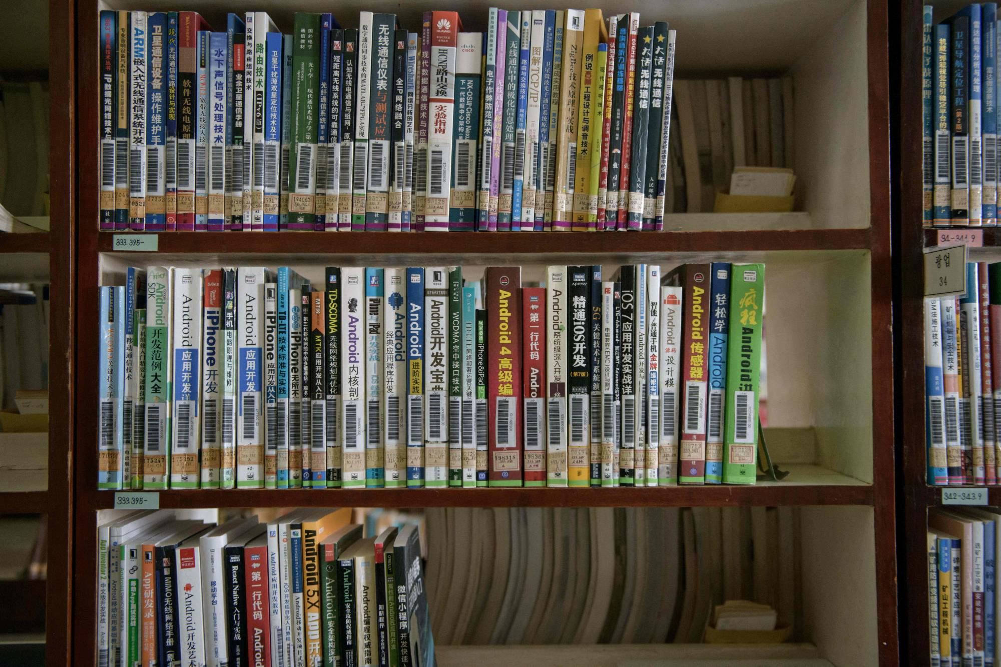 Books on internet protocols and computer and mobile phone operating systems at a library in Pyongyang   AFP-JIJI