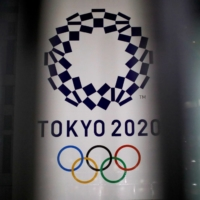While polls show a majority of Japan's citizens want the Olympics postponed or canceled, so far there's no indication Prime Minister Yoshihide Suga — who took power after Abe stepped down last year — will call them off.   REUTERS