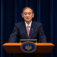 Prime Minister Yoshihide Suga speaks during a news conference in Tokyo on May 14.    AFP-JIJI