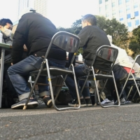 Japan mulls new cash handout for needy households as pandemic drags on