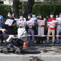 Myanmar expatriates hold a rally outside the Myanmar Embassy in Tokyo on Sunday after the military junta fired two diplomats who joined the anti-coup movement.   KYODO
