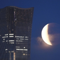 The eclipse as seen from Beijing on Wednesday    KYODO