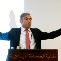 Former Nissan chairman Carlos Ghosn gestures as he speaks during a news conference in Beirut in January 2020. | REUTERS