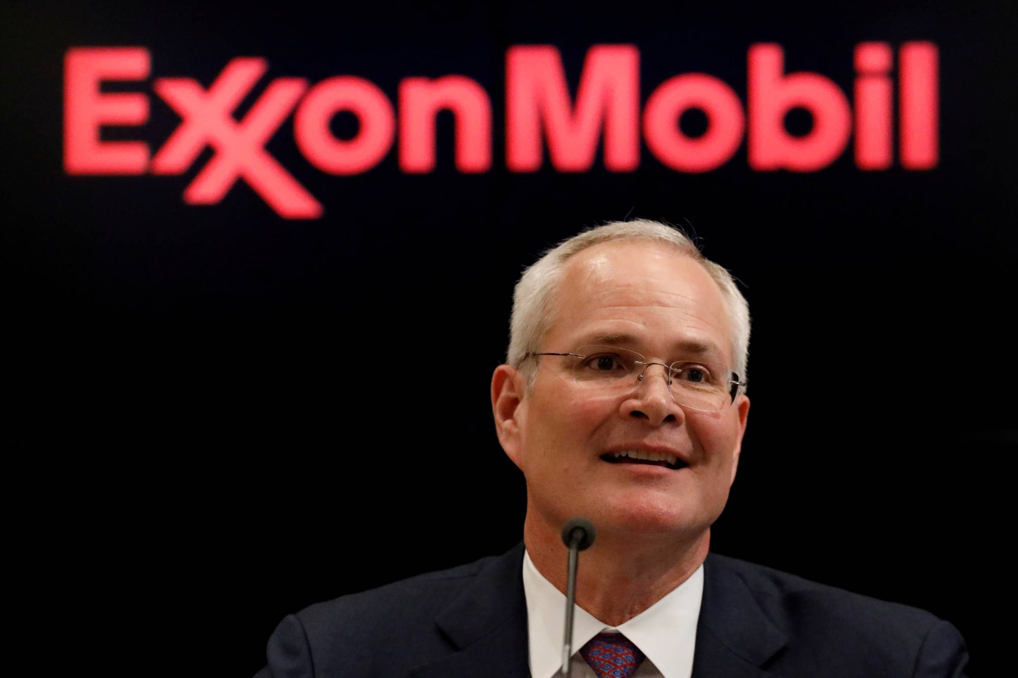 Darren Woods, chairman and CEO of Exxon Mobil Corporation, speaks during a news conference at the New York Stock Exchange in 2017.   REUTERS