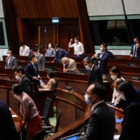 Hong Kong's Legislative Council voted 40-2 to approve measures Thursday creating a review committee to vet candidates for elected office and ensure they're 'patriots.' | AFP-JIJI