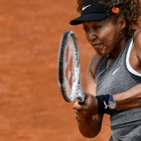 Naomi Osaka returns a shot to Jessica Pegula during their match of the Women's Italian Open at Foro Italico on May 12 in Rome. On Wednesday Osaka said will not take questions from the press at this year's French Open. | AFP-JIJI