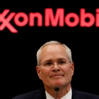 Darren Woods, chairman and CEO of Exxon Mobil Corp., gives a news conference at the New York Stock Exchange in 2017.   REUTERS
