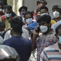 People line up outside a government dispensary to buy remdesivir, an antiviral drug, in Chennai, India, in April. | AFP-JIJI