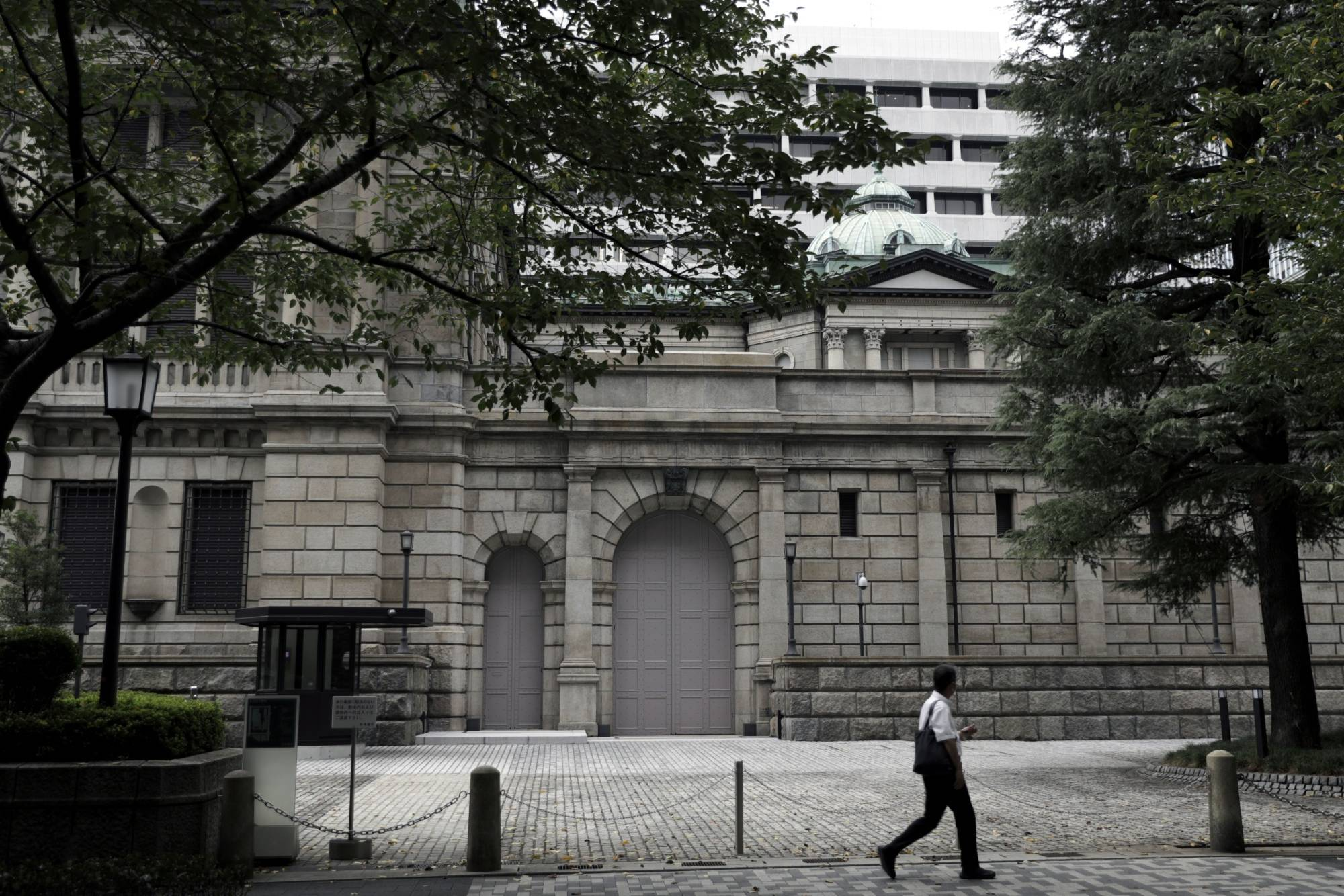 Assets held by the Bank of Japan have quadrupled in eight years under Gov. Haruhiko Kuroda's ultra-loose monetary policy.   BLOOMBERG