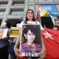 Myanmar residents in Japan take part in a rally in front of the United Nations University in Tokyo's Shibuya Ward on May 9 against the Feb. 1 military coup in Myanmar.   KYODO