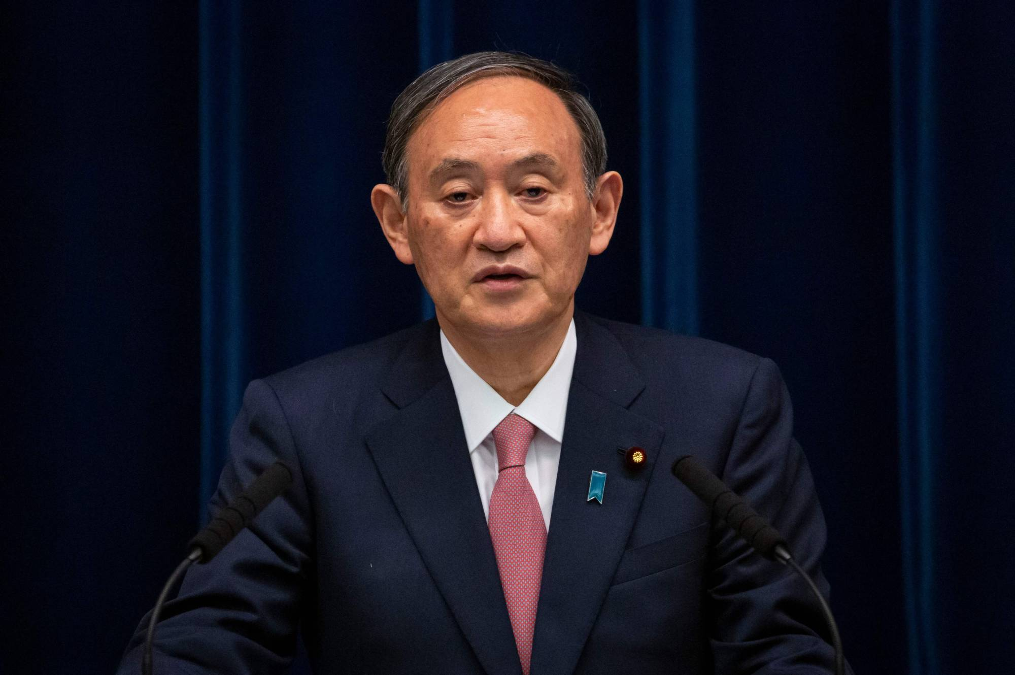 Prime Minister Yoshihide Suga speaks during a news conference in Tokyo on May 14.   POOL / VIA AFP-JIJI