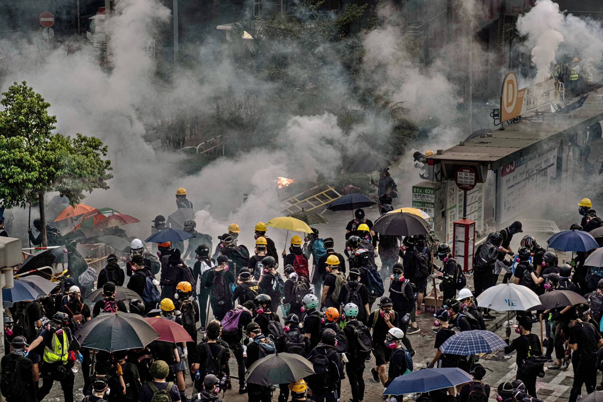 Pro-democracy protesters near a subway station in Hong Kong in October 2019 | LAM YIK FEI / THE NEW YORK TIMES
