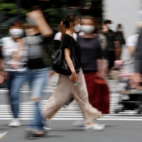 A shopping district in Tokyo on Friday | REUTERS