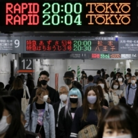A train station in Tokyo on Friday. The government is considering keeping quasi-emergency measures in place for in the capital and other areas even if the state of emergency is lifted June 20 as planned.  | REUTERS