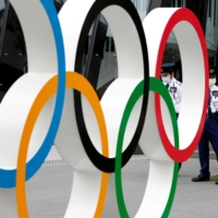 While the IOC has promised to hold a safe games even during the global health crisis, its COVID-19 guidelines, called the 'playbook,' also state that participants must be accountable for their decision to take part. | REUTERS