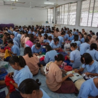 Inmates work at a sewing workship at a prison in Ayutthaya, north of Bangkok, in 2013. A coronavirus surge sweeping through Thailand's prisons has thrown the spotlight on conditions in the kingdom's overcrowded jails, where some inmates have less sleeping space than the inside of a coffin. | AFP-JIJI