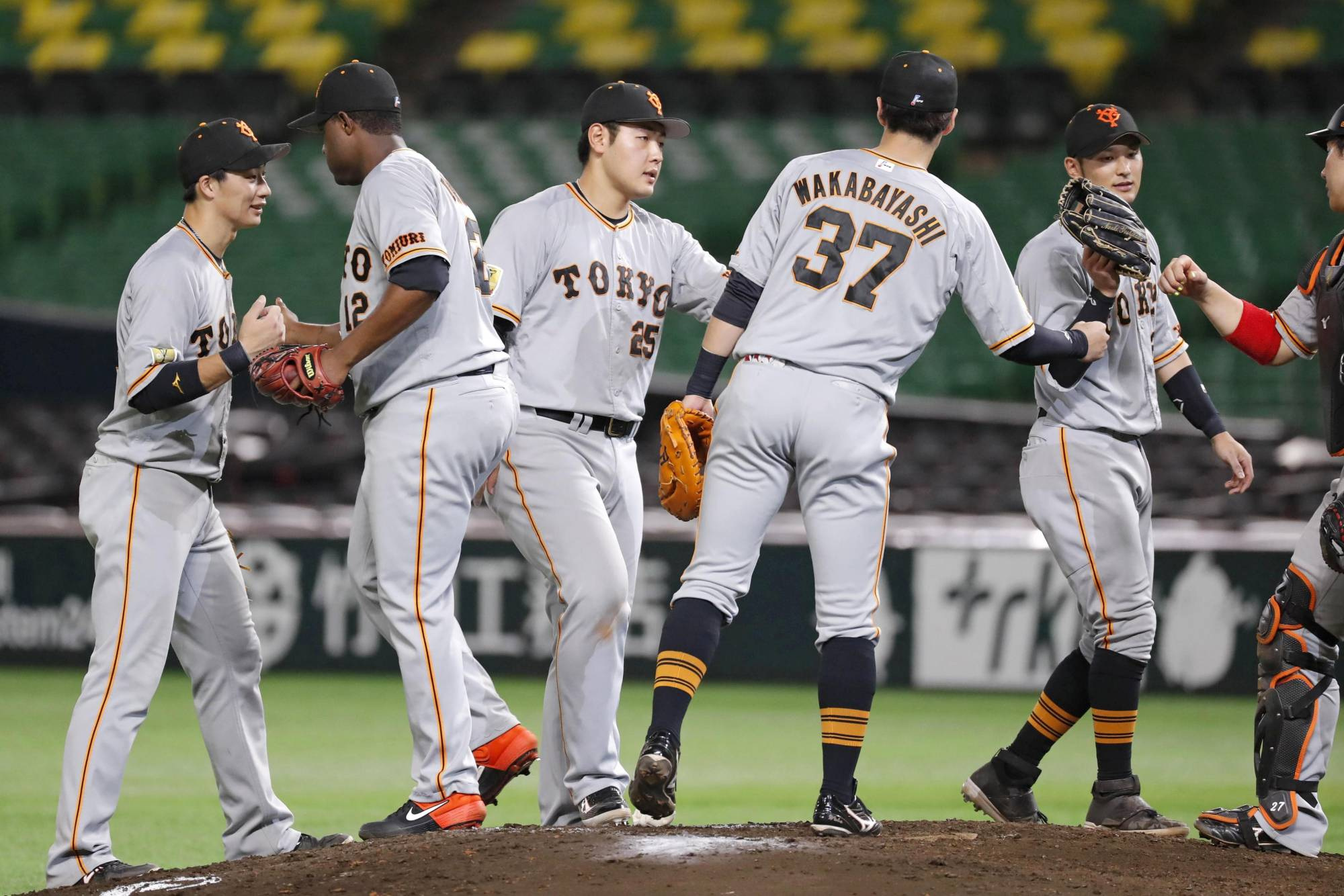 Yomiuri players celebrate after their win against the Hawks on Sunday in Fukuoka. | KYODO