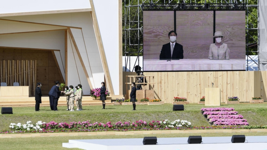 Japan's emperor and empress attend tree planting event remotely