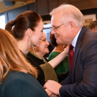 Australian Prime Minister Scott Morrison receives a traditional greeting from New Zealand Prime Minister Jacinda Ardern as he arrives for a welcoming ceremony during his visit in Queenstown on Sunday.  | VISITS AND CEREMONIAL OFFICE NEW ZEALAND / VIA AFP-JIJI