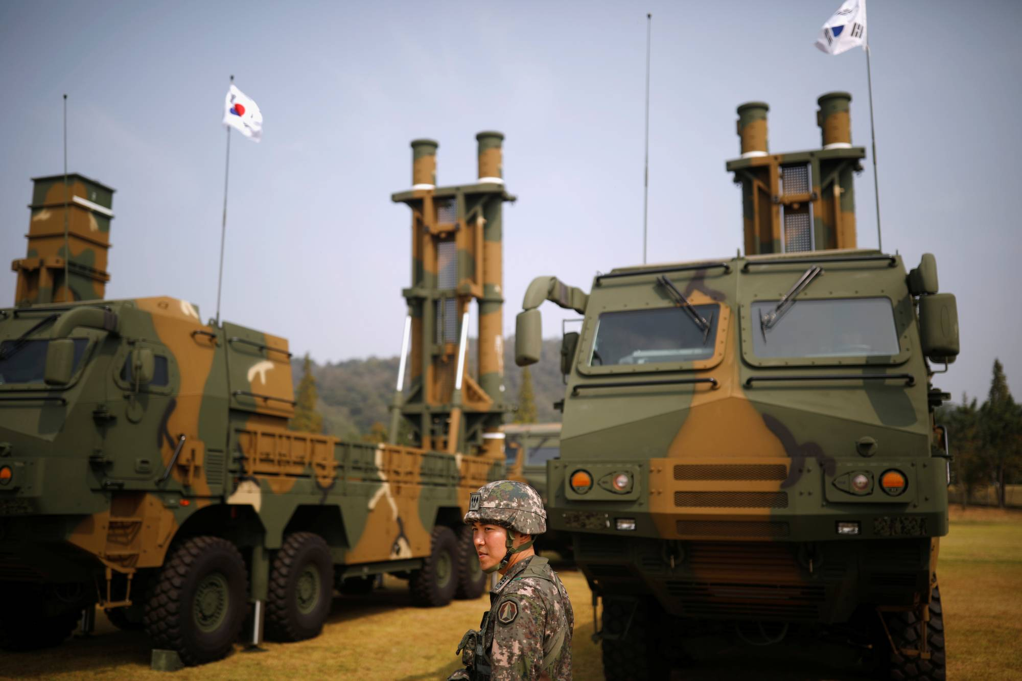 A South Korean soldier walks past Hyunmoo-2 (left) and Hyunmoo-3 ballistic missiles ahead of a celebration to mark the 69th anniversary of Korea Armed Forces Day, in Pyeongtaek, South Korea, in September 2017.    REUTERS