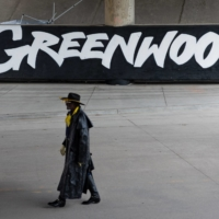 A man walks past a mural in the Greenwood district of Tulsa, Oklahoma, on Saturday, ahead of the 100th anniversary of the Tulsa race massacre. | BLOOMBERG