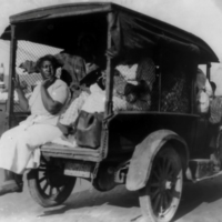 A truck carries African Americans during the race massacre in Tulsa, Oklahoma, in 1921.  | ALVIN C. KRUPNICK CO./NATIONAL ASSOCIATION FOR THE ADVANCEMENT OF COLORED PEOPLE (NAACP) RECORDS/LIBRARY OF CONGRESS/VIA REUTERS