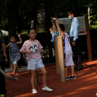 China announces three-child policy, in major policy shift