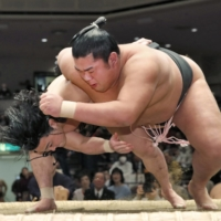 Shonannoumi (right), seen during a bout on Jan. 26, 2018, suffered a concussion during the New Year Basho that sparked widespread calls for change. | KYODO