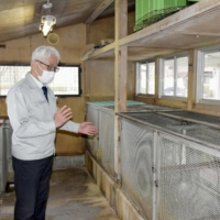 Empty cages, full inbox: Tsunenori Tsujimoto, the zoo director at Zoomo, speaks about animal euthanasia in Morioka, Iwate Prefecture, in April.   KYODO