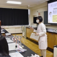 Emiko Michigami, a school nurse, says some students never realize that stress may be at the root of some health issues. | KYODO