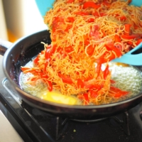 After gently combining your ham, egg, pepper and noodles, carefully pour the mixture into the pan.    SIMON DALY