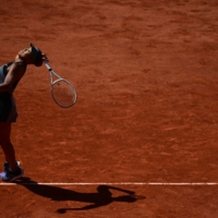 Japan's Naomi Osaka serves the ball to Romania's Patricia Maria Tig during their women's singles first round tennis match on the first day of the French Open in Paris on Sunday. | AFP-JIJI