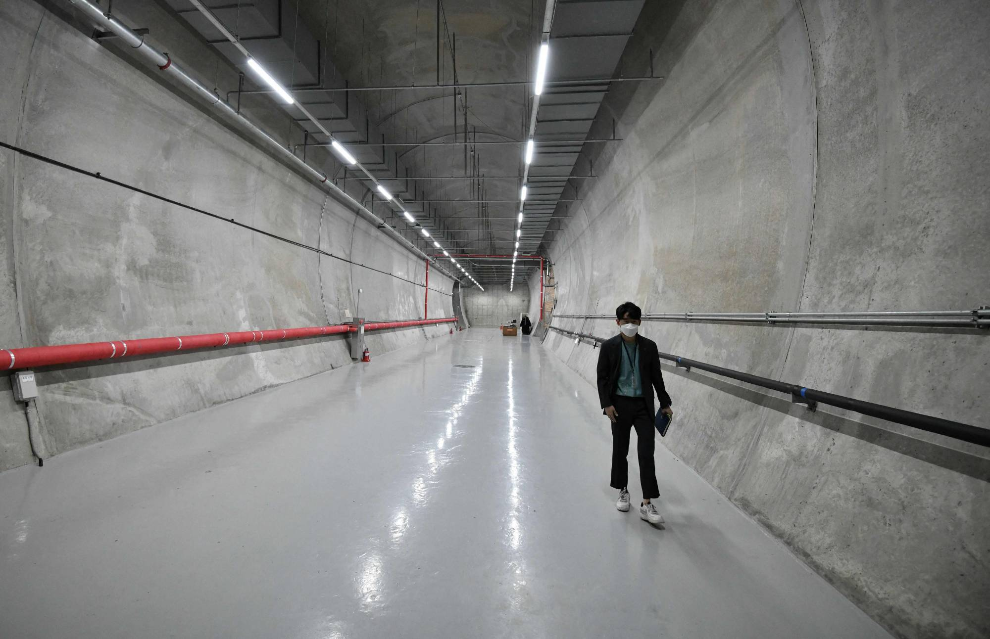 An official walks along a tunnel at the Baekdudaegan National Arboretum Seed Vault Centre in the southeastern mountainous county of Bonghwa, South Korea.   AFP-JIJI