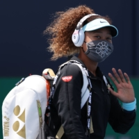 Japan's Naomi Osaka waves while walking onto the court prior to her match against Ajla Tomljanovic of Australia in the second round of the Miami Open in Miami on March 26.  | USA TODAY / VIA REUTERS