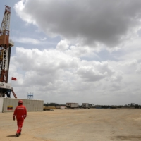 Drilling rigs at an oil well operated by Venezuela's state oil company PDVSA.    REUTERS