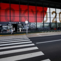 An advertisement for Tokyo 2020 Olympic and Paralympic Games is displayed at Narita International Airport in Chiba Prefecture on Tuesday.   REUTERS