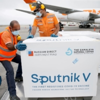 A shipment of Russia's Sputnik V coronavirus vaccine is handled at an airport in Caracas, Venezuela, on March 29. | REUTERS