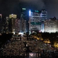 People attend a candlelight vigil at Victoria Park in Hong Kong in June 2019 to mark the 30th anniversary of the 1989 Tiananmen crackdown.  | AFP-JIJI