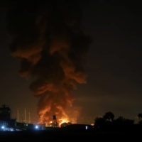 Smoke rises at an oil refinery in Tehran. Part of the danger of cheap offsets is that they can be used to avoid the hard work of actually cutting emissions.   WEST ASIA NEWS AGENCY / VIA REUTERS