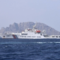 A China Coast Guard ship is seen near the Senkaku Islands in February. Chinese government ships were spotted around the islands for the 112th straight day on Friday, the longest such streak since data became available in September 2012. | HITOSHI NAKAIMA / VIA KYODO