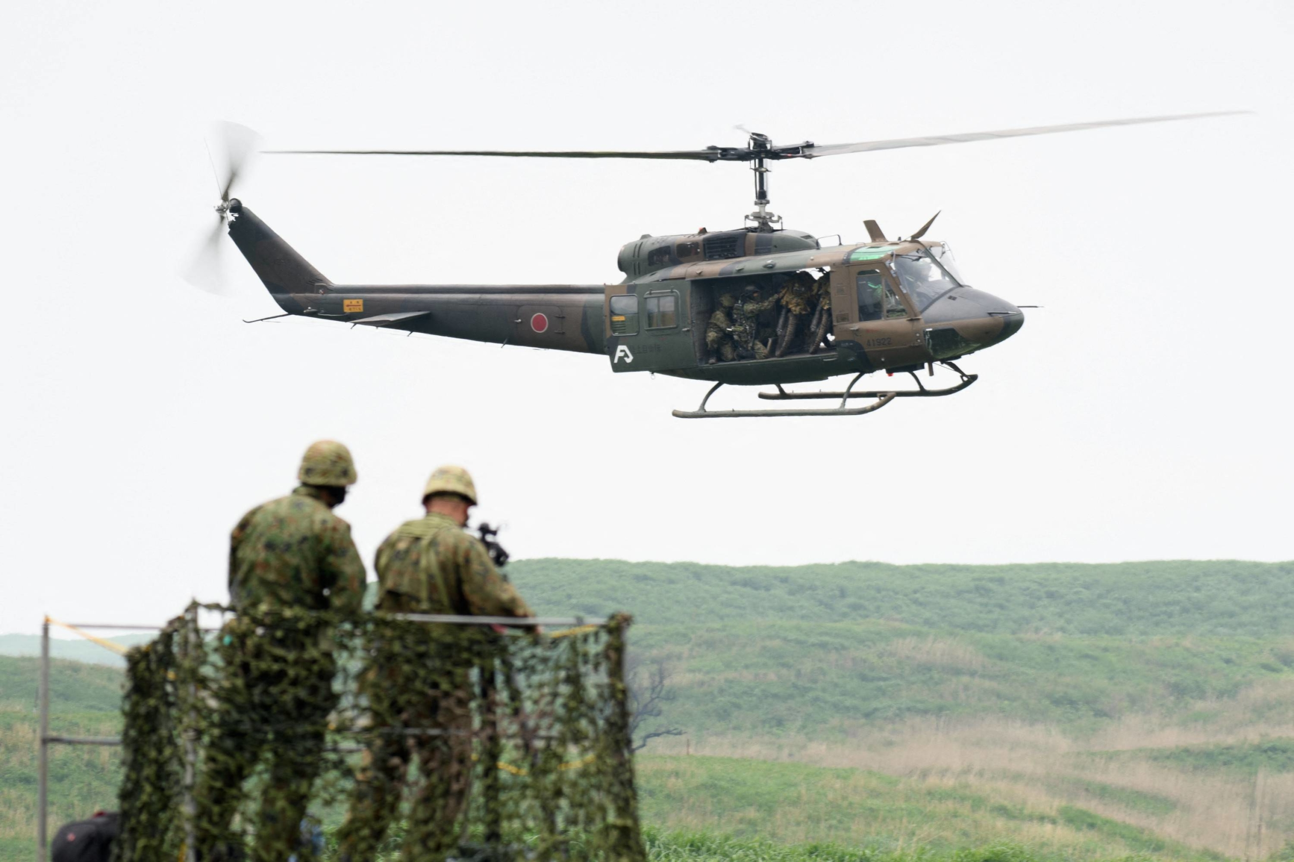 Self-Defense Forces troops take part in a training exercise in the East Fuji Manuever Area in Gotemba, Shizuoka Prefecture, on May 22.  | POOL / VIA AFP-JIJI
