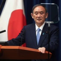 Prime Minister Yoshihide Suga speaks during a news conference on May 28.  | POOL / VIA REUTERS