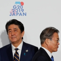 Prime Minister Shinzo Abe and South Korean President Moon Jae-in at the G20 leaders summit in Osaka in June 2019. Leaders of Japan and South Korea haven't held a summit since December of that year amid frosty ties.  | REUTERS