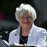 U.S. Treasury Secretary Janet Yellen smiles during a news conference at Winfield House in London on Saturday after attending the Group of Seven finance ministers' meeting.  | POOL / AFP-JIJI