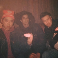 Ash Hudson (center) poses with DJ Tanko (left) and DJ Kensaw (right) in Japan in 1991.