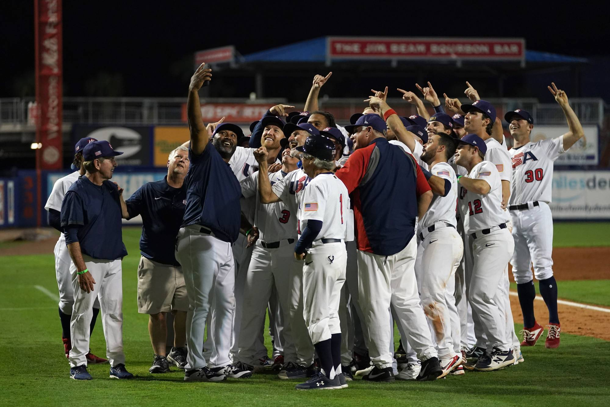 Team USA players celebrate after defeating Venezuela to qualify for the Tokyo Olympics on Saturday in Port St. Lucie, Florida. | USA TODAY / VIA REUTERS