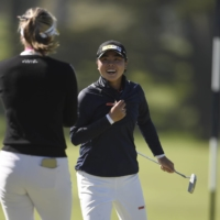 Fellow golfers spray champagne on Yuka Saso after her winning putt on the ninth green during the sudden death playoff on Sunday. | USA TODAY SPORTS / VIA REUTERS